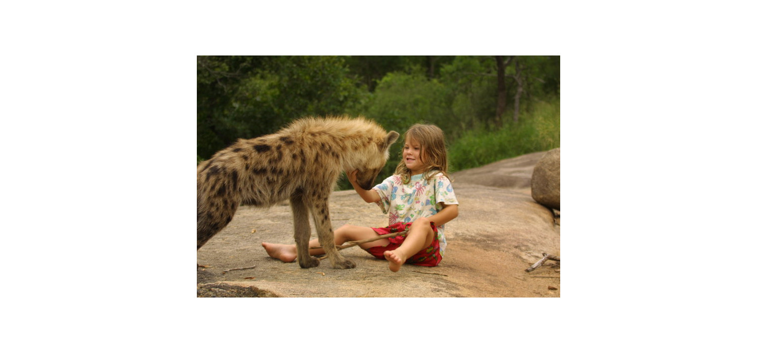 Young Penny Wolhuter wins the trust and befriends a hyena cub.