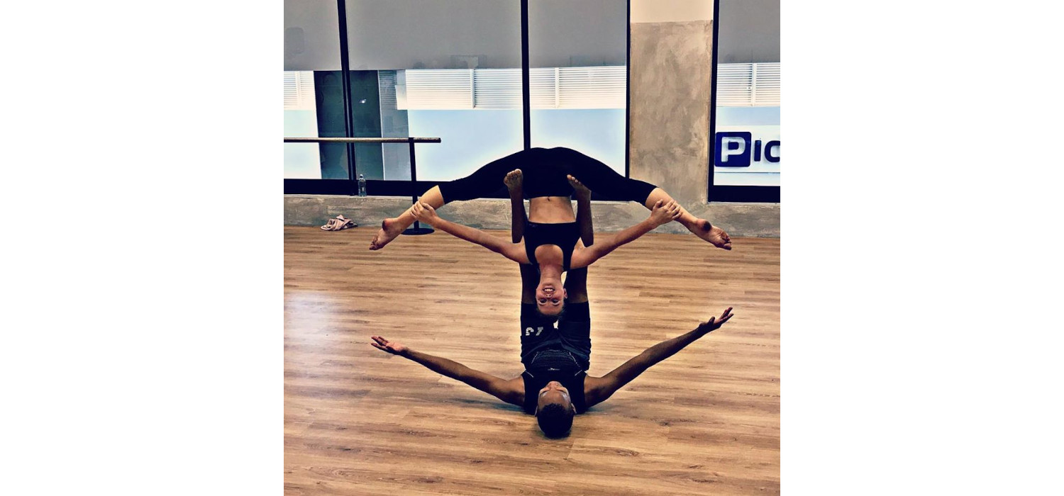 Penny experimenting Pas de Deux lifts at Oakfields College with classmate Thandaza Silwane